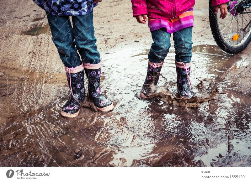 human children Joy Leisure and hobbies Playing Child Human being Infancy Legs Feet Earth Autumn Weather Bad weather Rain Fashion Clothing Pants Footwear