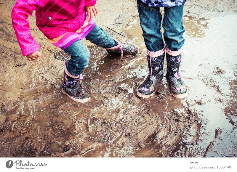 Human being Child Joy Cold Autumn Playing Legs Small Fashion Feet Rain Weather Leisure and hobbies Earth Dirty Infancy
