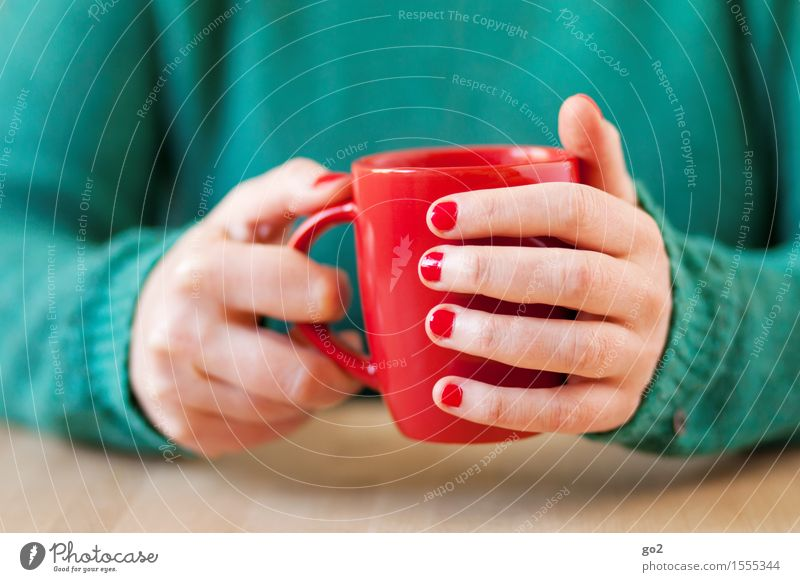 Red cup To have a coffee Beverage Drinking Hot drink Coffee Tea Cup Mug Lifestyle Personal hygiene Manicure Nail polish Living or residing Table Human being