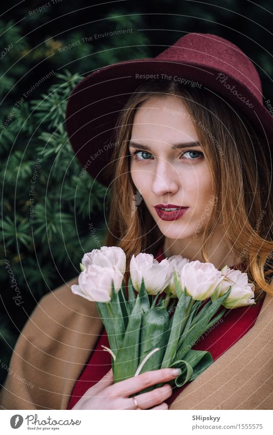 Pretty woman standing with white flowers Elegant Happy Beautiful Skin Face Make-up Spa Summer Human being Girl Woman Adults Lips Nature Sky Flower Fashion Hat
