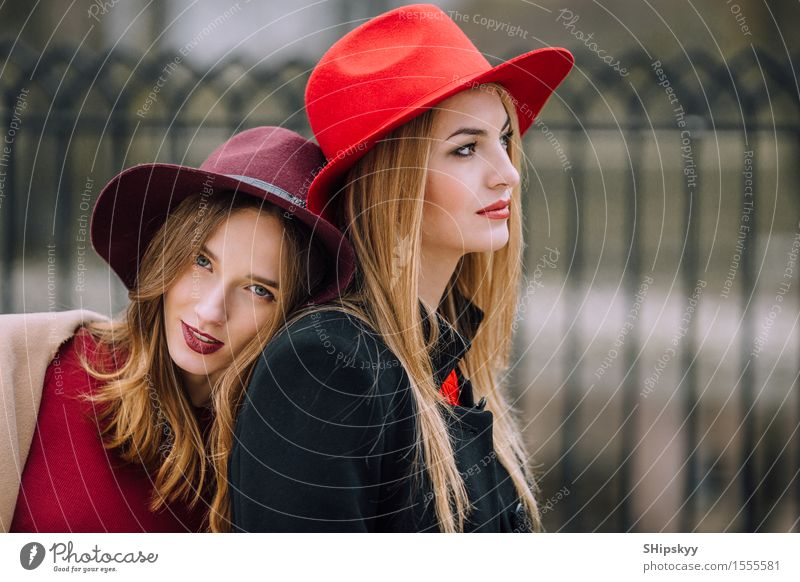 Two girls sitting on the bench and smile Lifestyle Joy Happy Beautiful Face Meeting Human being Feminine Woman Adults Friendship Autumn Fashion Hat Listening