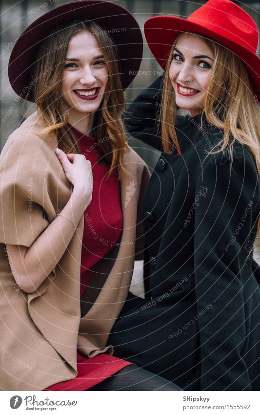 Two girls sitting on the bench and smile Lifestyle Joy Happy Beautiful Face Meeting To talk Human being Feminine Woman Adults Friendship Teeth Autumn Fashion