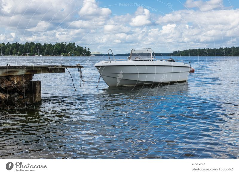 Boat on the Swedish coast Relaxation Vacation & Travel Tourism Island Nature Landscape Clouds Tree Coast Baltic Sea Watercraft Blue Green Skerry Swede Lidingö