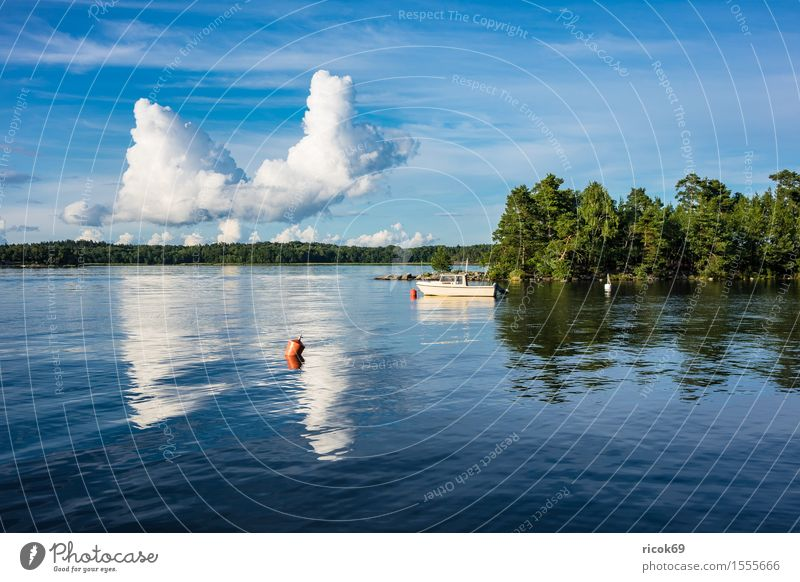 Nature Vacation & Travel Blue Green Tree Relaxation Landscape Clouds Coast Watercraft Tourism Island Baltic Sea Buoy Skerry