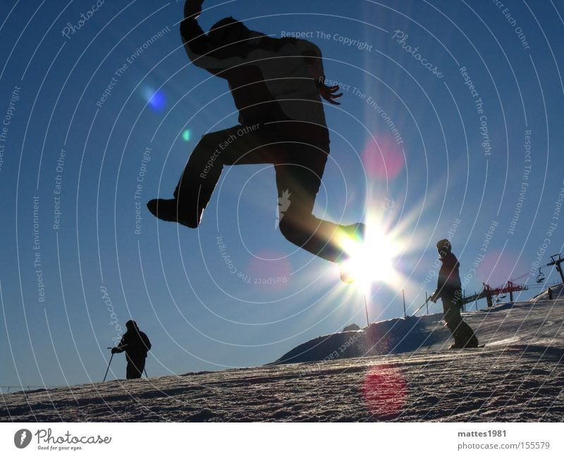 Walking on sunshine Sun Winter Vacation & Travel Skiing Joy Jump Go up Go crazy Snow Sports Playing Flying Back-light Sunbeam Blue sky Cloudless sky Applause
