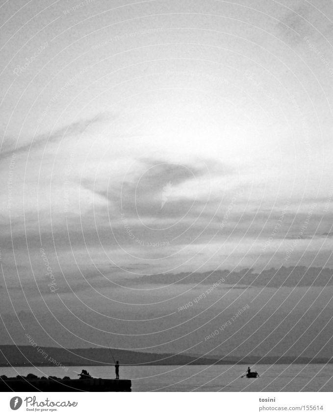 Human being Water Sky Ocean Beach Vacation & Travel Clouds Far-off places Mountain Watercraft Horizon Rock Fish Fisherman Angler