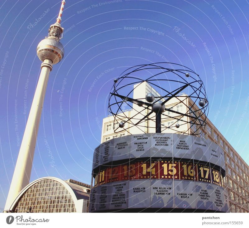 Berlin Alexanderplatz with television tower and world time clock in front of a blue sky Earth Town Capital city Landmark Monument Digits and numbers Time