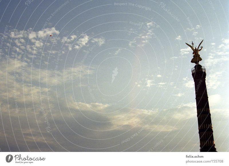 Sky Sun Summer Clouds Far-off places Berlin Freedom Stone Air Gold Gold Large Poverty Perspective Angel Infinity