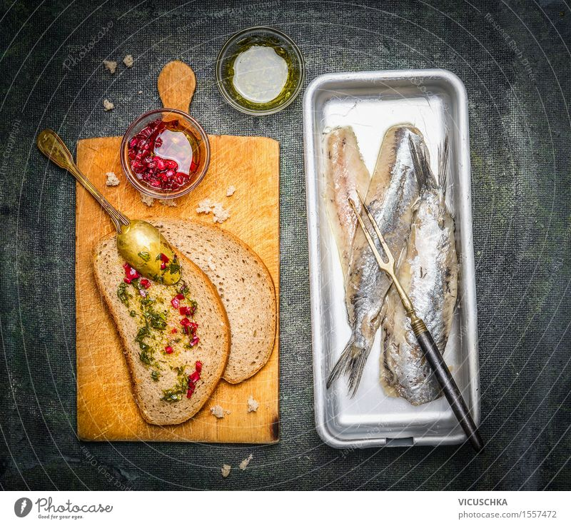 Pickled herrings with slices of bread and onion sauce Food Fish Bread Herbs and spices Cooking oil Nutrition Lunch Buffet Brunch Banquet Organic produce