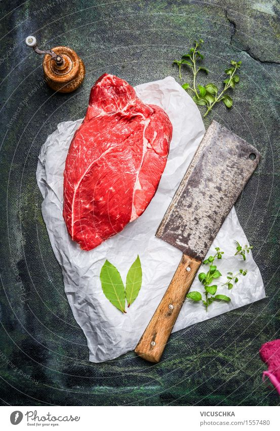 piece of raw meat on white paper with cleaver Food Meat Herbs and spices Nutrition Lunch Organic produce Diet Knives Healthy Eating Table Kitchen Restaurant