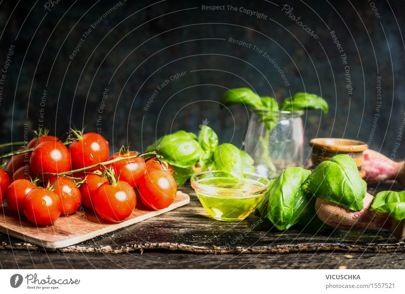 Cherry tomatoes with oil and basil on the kitchen table Food Vegetable Lettuce Salad Herbs and spices Cooking oil Nutrition Lunch Dinner Buffet Brunch