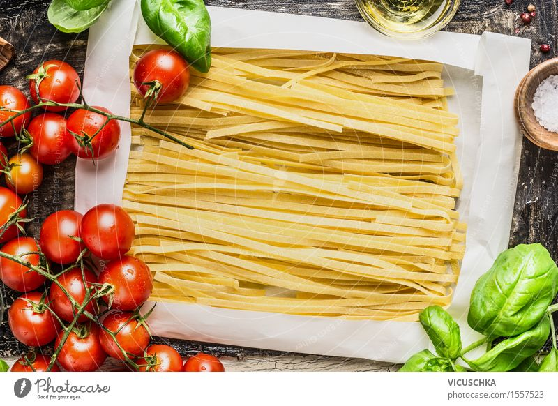 egg noodles in wrapping paper and fresh ingredients for cooking Food Vegetable Grain Dough Baked goods Herbs and spices Nutrition Lunch Dinner Organic produce