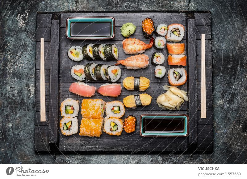 Sushi served on a dark wooden plate Food Fish Grain Herbs and spices Nutrition Lunch Dinner Asian Food Style Healthy Eating Table Restaurant Design Lemur nigiri