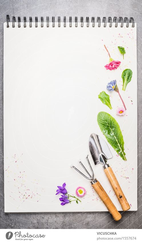 Garden tools with flower parts on empty notebook . Style Design Summer Decoration Nature Plant Spring Flower Leaf Blossom Paper Piece of paper Sign Ornament