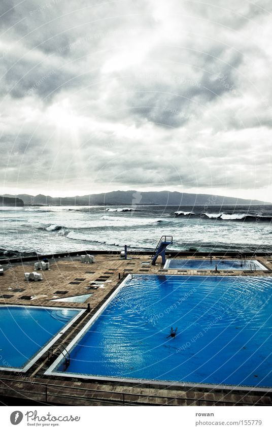 lonely swimmer Colour photo Exterior shot Copy Space top Day Wellness Relaxation Swimming & Bathing Vacation & Travel Beach Ocean Swimming pool Water Sky Clouds