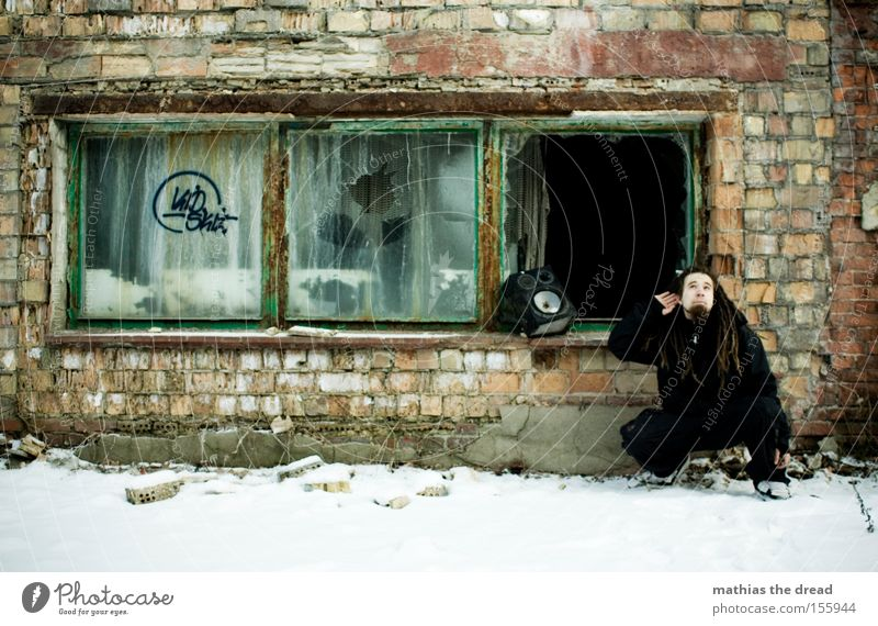 eavesdropping attack Music Loudspeaker Youth culture Dreadlocks Wall (building) Brick Snow Window Cold Listening Old Shabby Derelict Concert Man