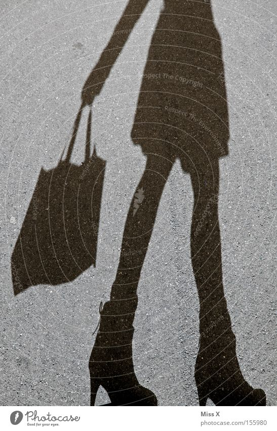 shopping spree Shopping Woman Adults Legs Street Footwear Gray Black Joie de vivre (Vitality) Asphalt Stony In transit Shadow play Gravel Paper bag Consumption