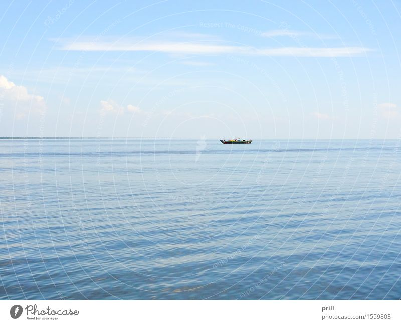 lonely boat in Cambodia Ocean Culture Water Horizon Rowboat Watercraft Small Loneliness Dangerous Tradition Survive Surface Asia forsake sb./sth. peril Barque
