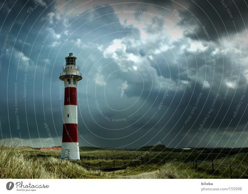 In the middle of the storm Light Clouds Climate Weather Gale Rain Thunder and lightning Coast North Sea Tower Lighthouse Architecture Landmark Monument Red