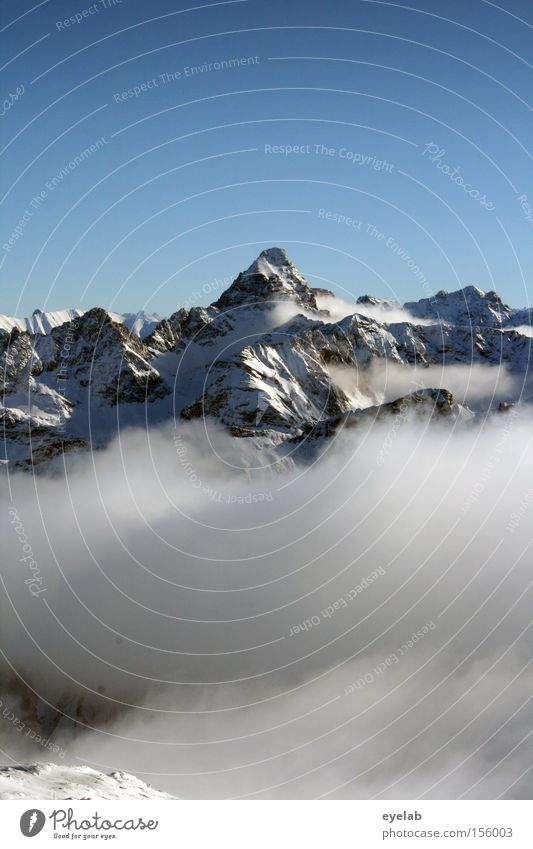 Sky Winter Clouds Far-off places Snow Mountain Horizon Rock Vantage point Alps Peak Valley Sublime Monumental