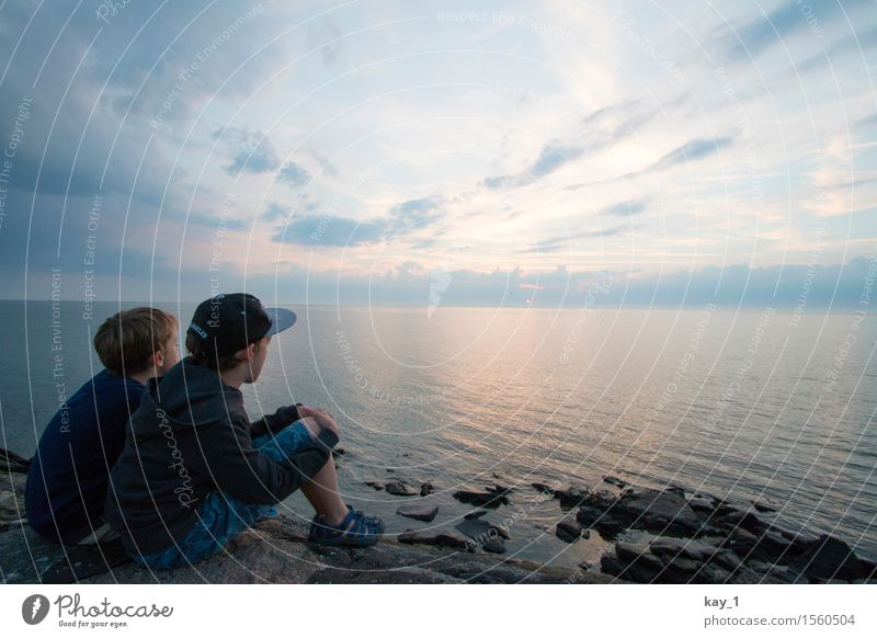 Human being Child Sky Vacation & Travel Summer Water Sun Ocean Calm Far-off places Coast Boy (child) Freedom Stone Together Friendship