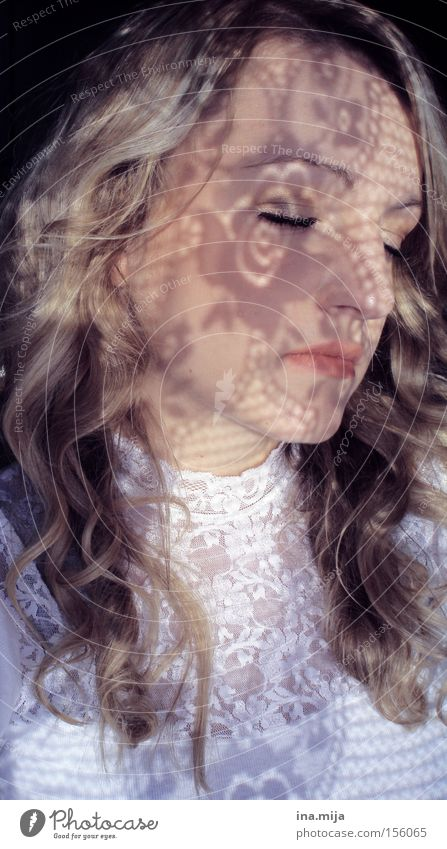 young blonde woman with curly hair has her eyes closed and shadows on her face pretty Hair and hairstyles Skin Face Cosmetics Make-up Contentment Relaxation