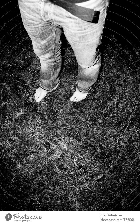 barefoot Barefoot Black & white photo Night Grass Gray Dark Joy Crazy Loneliness Human being Winter Cold Man Lawn Jeans Feet