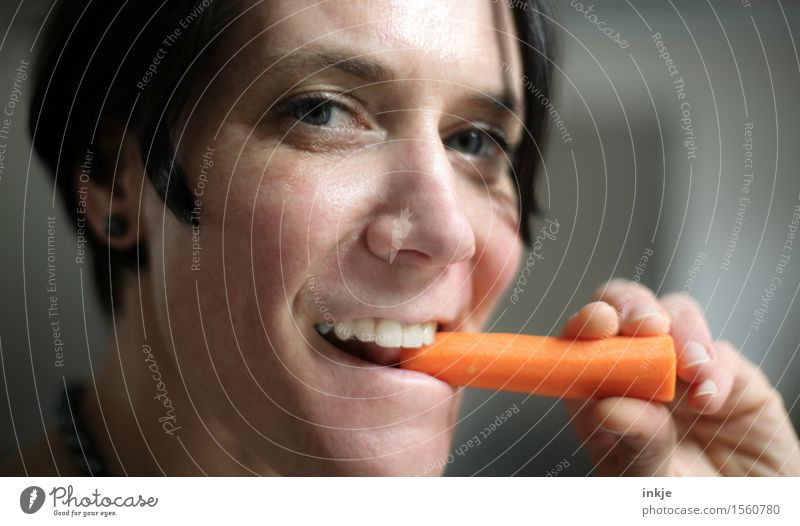 Eating carrots is healthy. Vegetable Carrot Nutrition Organic produce Vegetarian diet Finger food Healthy Healthy Eating Woman Adults Life Face 1 Human being