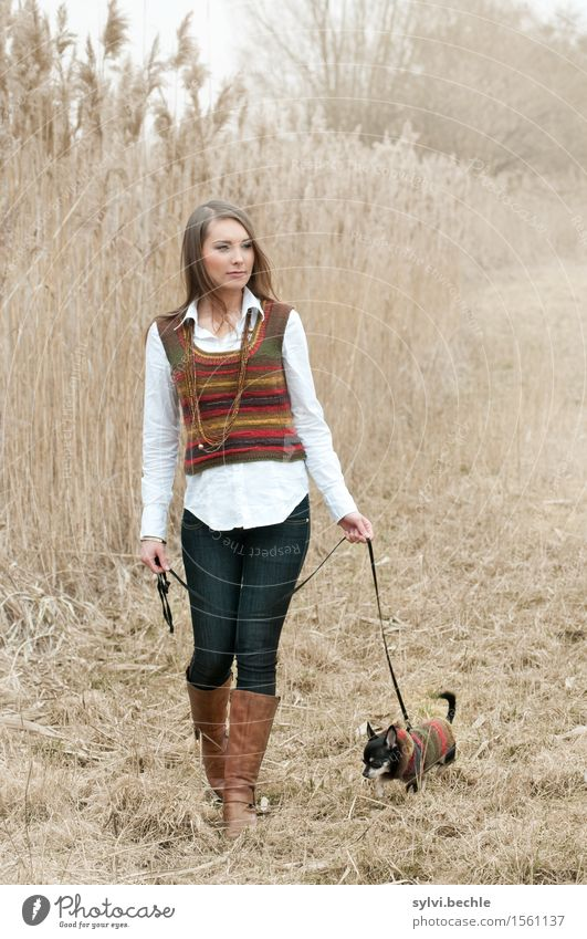 take a dog for a walk Leisure and hobbies Human being Feminine Young woman Youth (Young adults) Life 18 - 30 years Adults Nature Autumn Bad weather Fog Fashion