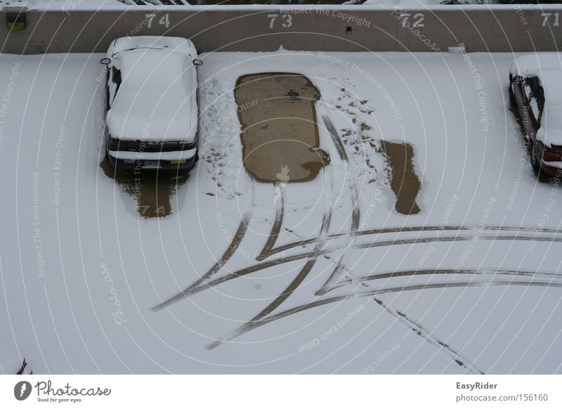 backwards Snow Motor vehicle Parking lot Tracks Tire Traffic infrastructure park Car