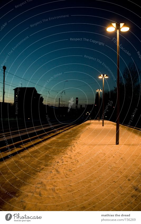 NIGHTLY WAITING PART II Platform Railroad tracks Cable Lantern Artificial light Snow Twilight Blue House (Residential Structure) Silhouette Deserted Loneliness