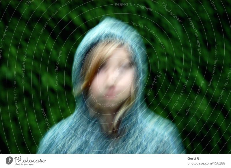 bemused Girl Face Hooded (clothing) Cardigan Blur Blonde Green Blue Wind Fir tree Child Emotions Crazy Distorted Muddled Hair and hairstyles Sadness Irritation