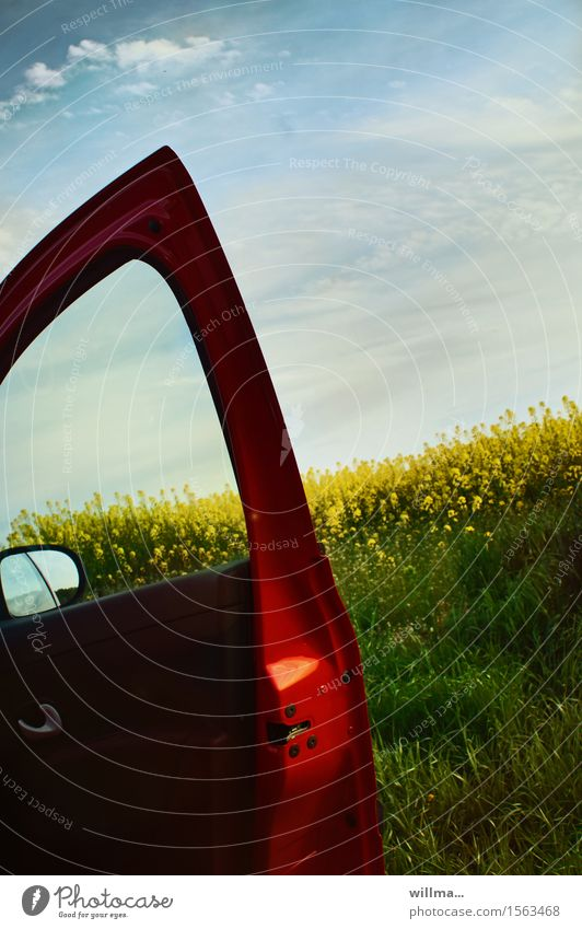 suburban blues Spring Canola field Oilseed rape flower Agricultural crop Car door Rear view mirror Red Spring day Trip Nature Colour photo Exterior shot