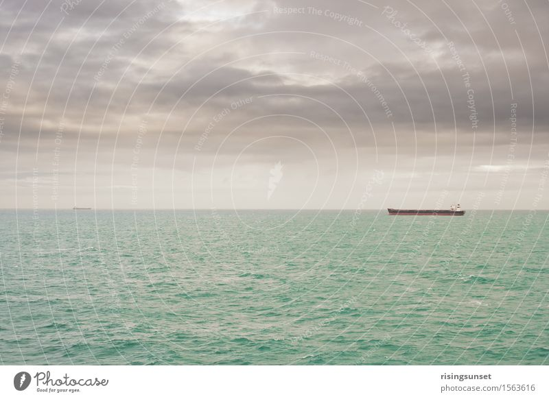 On the high seas Logistics Environment Water Sky Clouds Storm clouds Horizon Winter Bad weather North Sea Baltic Sea Ocean Navigation Container ship