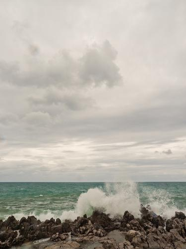 breakwater Elements Air Water Sky Clouds Summer Coast Ocean Power Might Stone Wave break Waves Threat Splash of water Rock Colour photo Subdued colour
