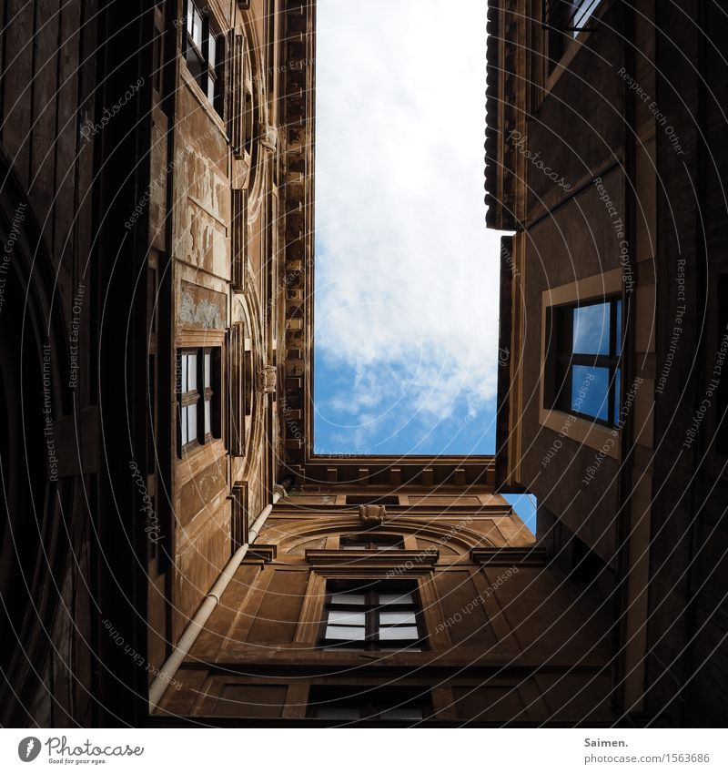 View into the sky Sky Clouds Blue sky houses Window Facade Rain gutter Building Manmade structures Architecture Old Historic Europe Town Deserted Colour photo