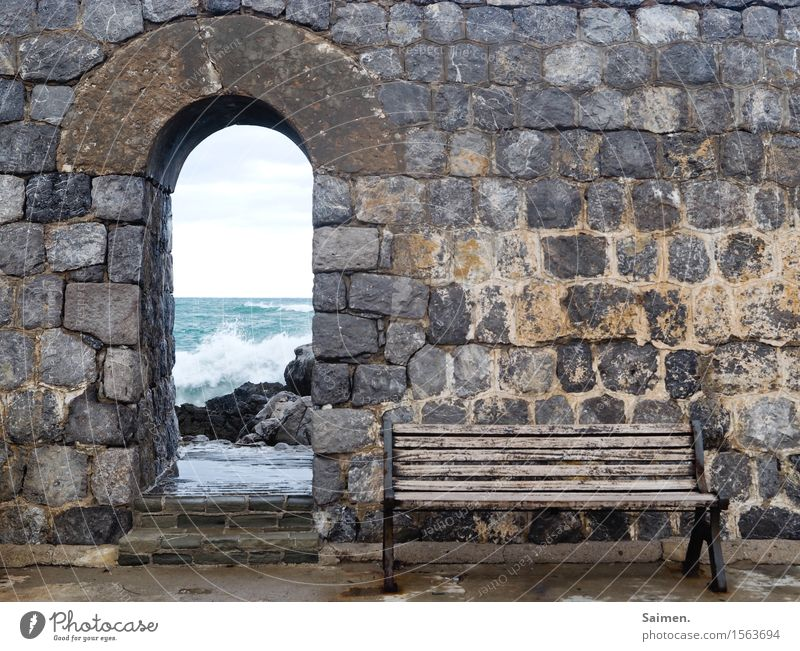 Bank at the sea in front of wall Ocean ocean Bench bench Rock stones Wall (barrier) City wall Italy Mediterranean sea Waves Surf detail Coast White crest Nature
