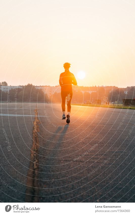 Woman jogging into a sunrise Body Healthy Athletic Fitness Contentment Adventure Summer Sun Sunbathing Sports Sports Training Jogging Human being Feminine