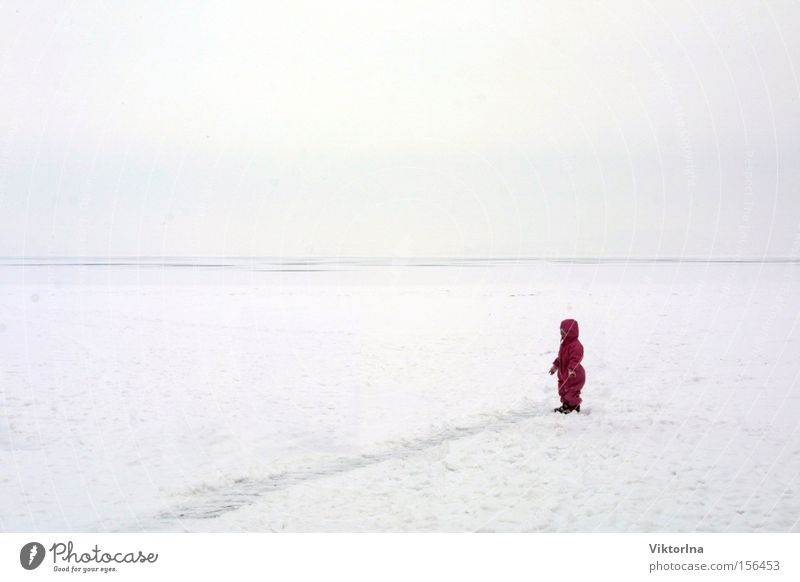 ice desert Snow Ice Cold Lake Balaton Doomed Loneliness Child Small Masked Snowsuit Tracks Desert Fear Patch of colour Winter Lost