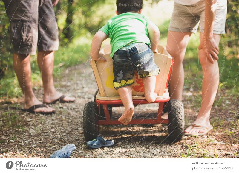 Boy climbs barefoot on ladder truck in nature Leisure and hobbies To go for a walk Trip Summer Parenting Human being Masculine Feminine Child Boy (child)