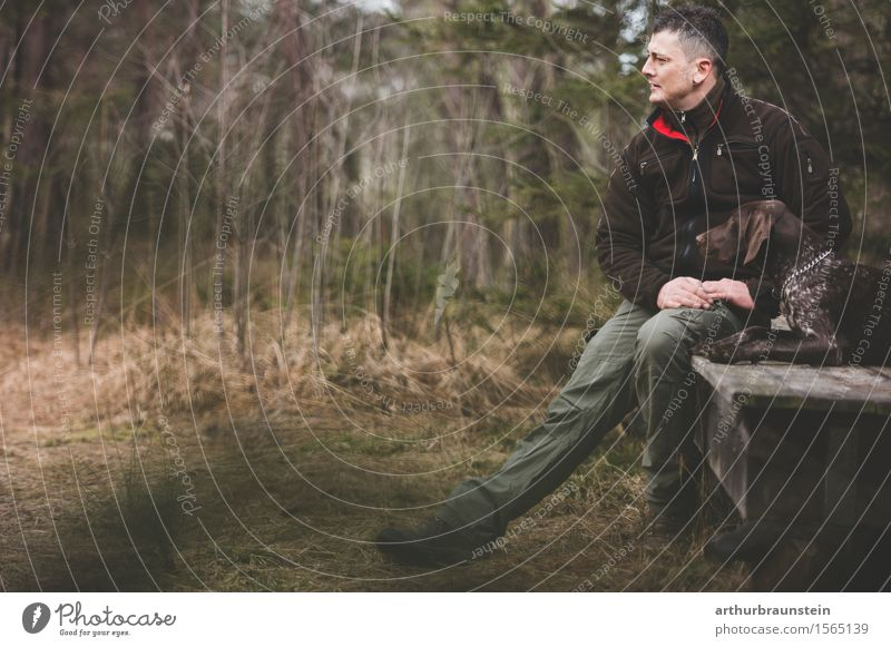 Man with dog in front of wooden hut Leisure and hobbies Hunting Human being Masculine Young man Youth (Young adults) Friendship Life 1 30 - 45 years Adults