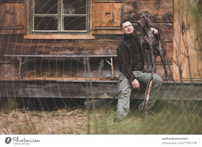 Hunter with his dog Leisure and hobbies Hunting Trip Hiking House (Residential Structure) Human being Masculine Young man Youth (Young adults) Friendship Life 1