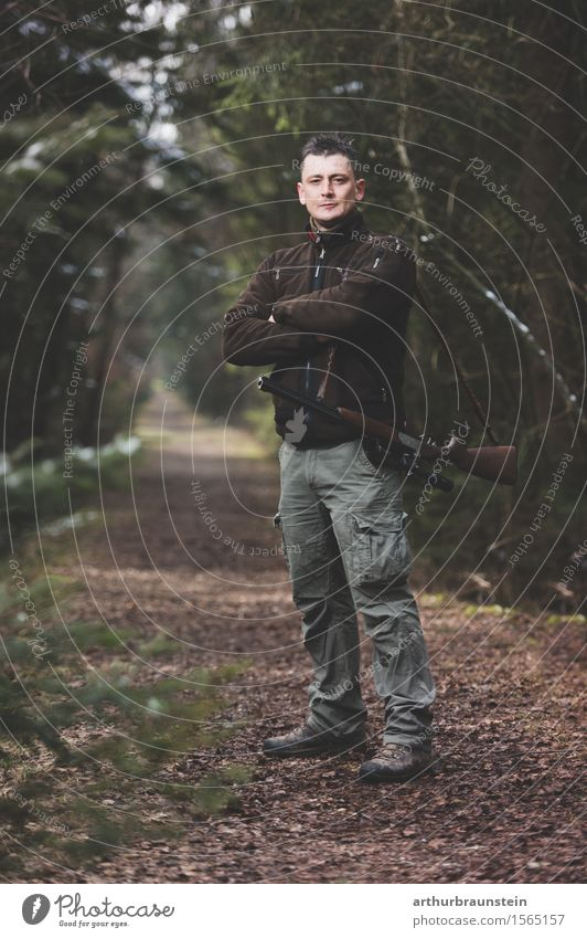 Young hunter with rifle stands in the forest Leisure and hobbies Hunting Hiking Promenade Hunter Human being Masculine Young man Youth (Young adults) Adults