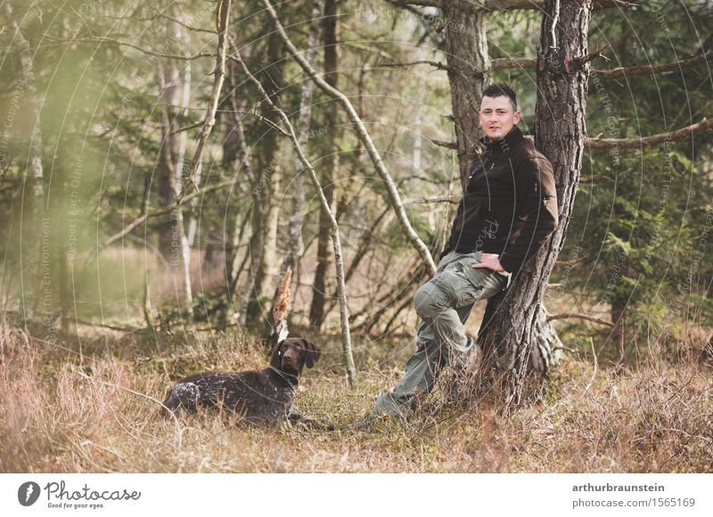 Young man with dog in the forest Leisure and hobbies Hunting Trip Hiking To go for a walk Forester Hunter Human being Masculine Youth (Young adults) Adults Life