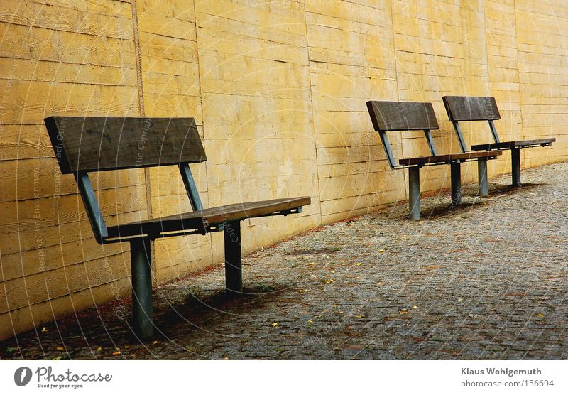 Calm Loneliness Wall (building) Park Bench Sidewalk Traffic infrastructure Cobblestones Paving stone Useless