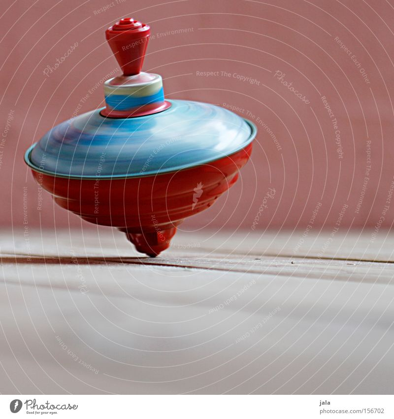 Turn around... turn around... Dance Contentment Rotate Rotation Gyroscope Wooden floor Colour Red Multicoloured Tin Toys Movement Wall (building) Joy