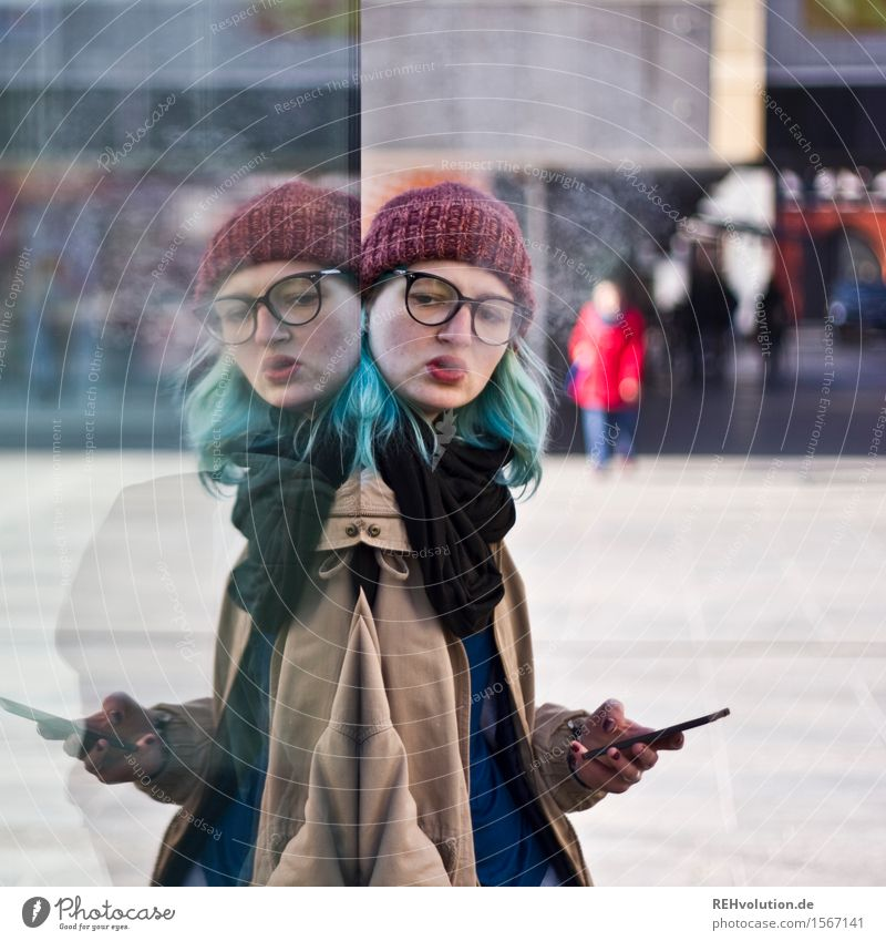 Human being Youth (Young adults) City Young woman Loneliness Winter 18 - 30 years Cold Adults Feminine Hair and hairstyles Telecommunications Uniqueness