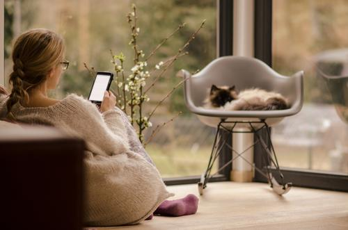 Woman with mobile phone at home Lifestyle Luxury Elegant Style Design Reading Living or residing Flat (apartment) House (Residential Structure) Chair