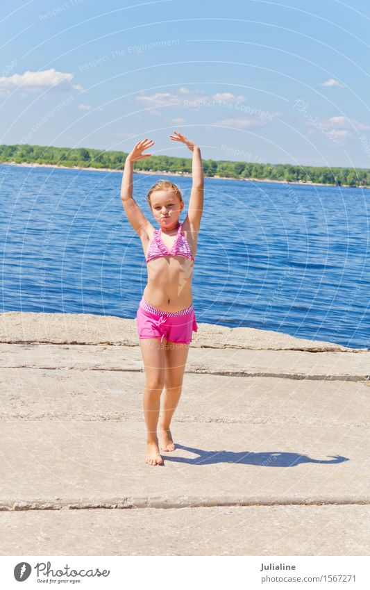 Girl on the riverbank in pink swimsuit Joy Playing Summer Beach Ocean Child Schoolchild Woman Adults Infancy 8 - 13 years River bank Blonde Movement Smiling