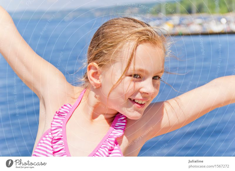 Dancing girl on the riverbank Joy Playing Summer Beach Ocean Child Schoolchild Girl Woman Adults Infancy 1 Human being River bank Blonde Movement Smiling Pink